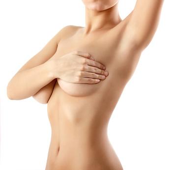 woman examining breast