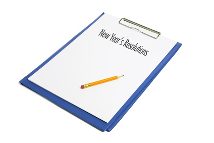New Year's Resolutions and Clipboard on White Background